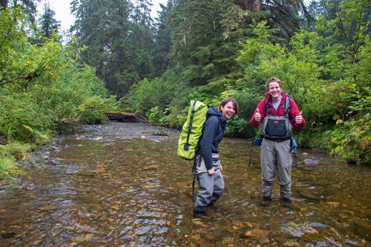 ACRC interns Mollie Dwyer and Connor Johnson pose while crossing a creek.